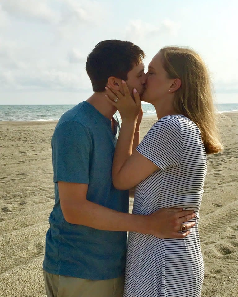 Couple celebrating an engagement on Holden Beach