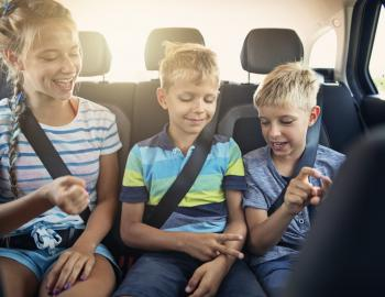 Kids Playing Games in Car