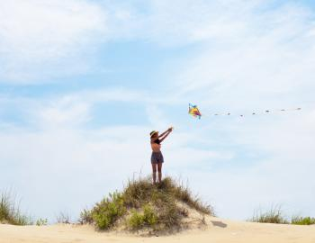 kite flying on beach bluff