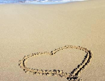 heart drawn in sandy beach