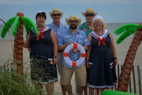 Family dressed up in sailor outfits on Holden Beach