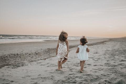 Two little girls running on Holden Beach