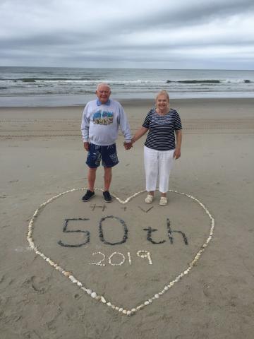 Couple celebrating their 50th wedding anniversary on Holden Beach