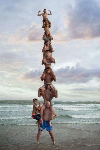 Family stacked on each others shoulders on Holden Beach