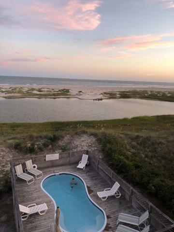 Beautiful sunset and oceanfront pool on Holden Beach