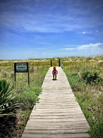 toddler walking boardwalk to holden beach