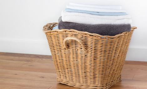 Basket of Clean Towels and Sheets