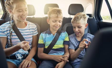 Kids Playing Games in Car