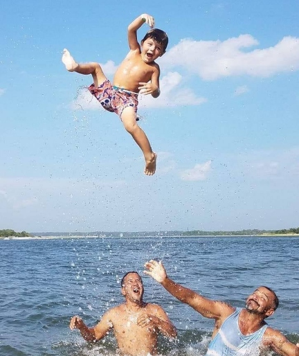 kid-playing-in-water-with-adults