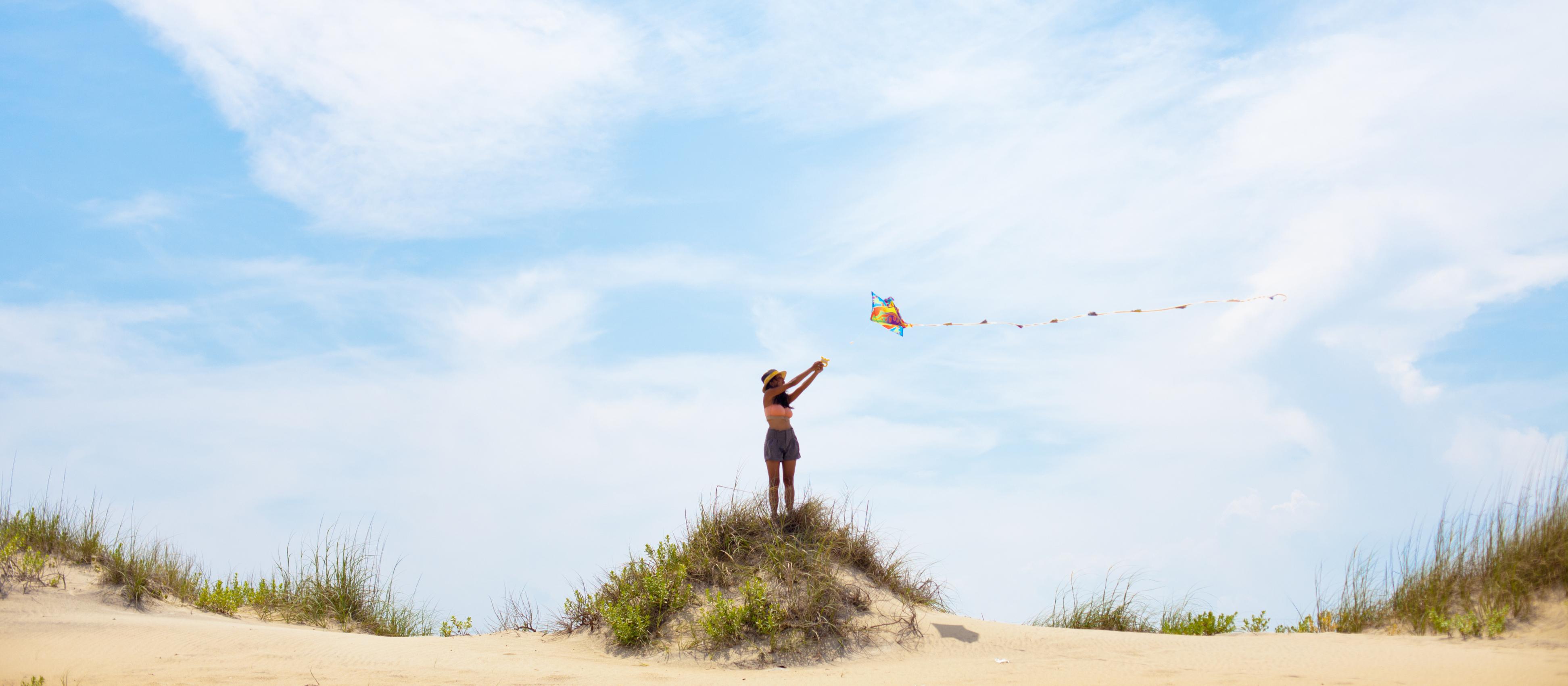 kite flying on beach bluff